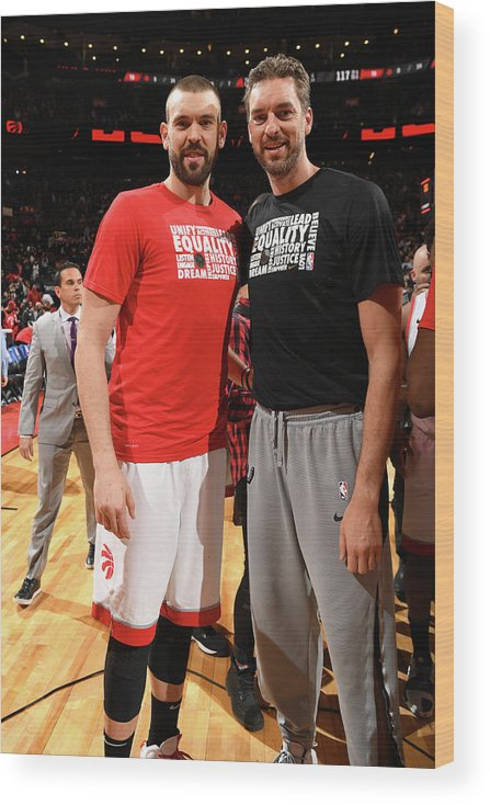 Nba Pro Basketball Wood Print featuring the photograph Marc Gasol and Pau Gasol by Ron Turenne