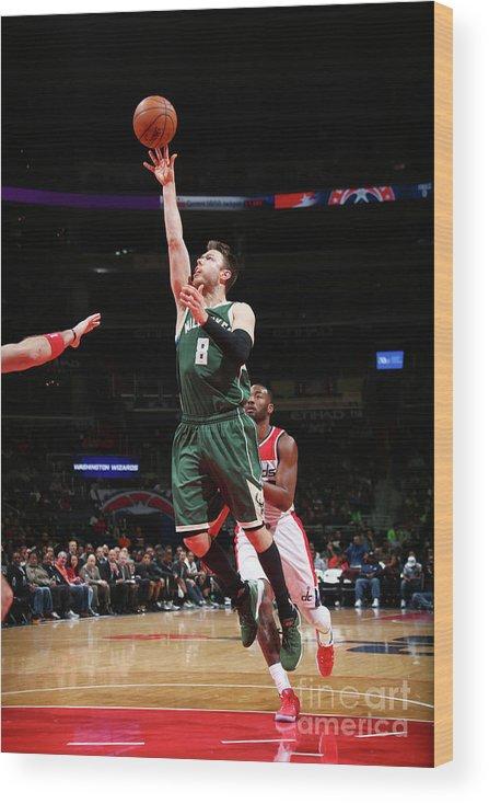 Nba Pro Basketball Wood Print featuring the photograph Matthew Dellavedova by Ned Dishman