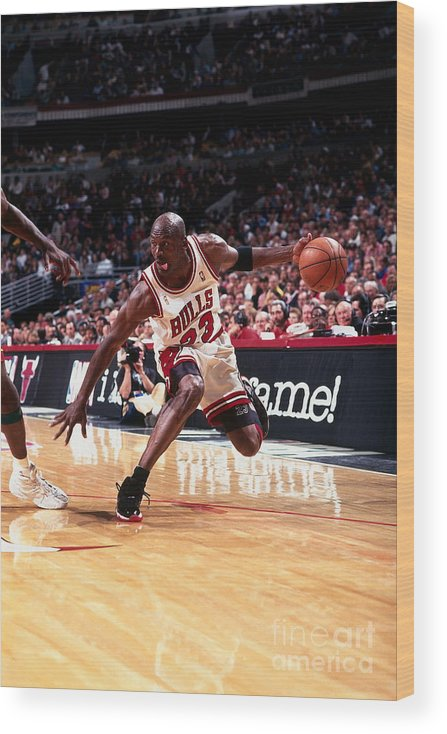 Chicago Bulls Wood Print featuring the photograph Michael Jordan by Barry Gossage