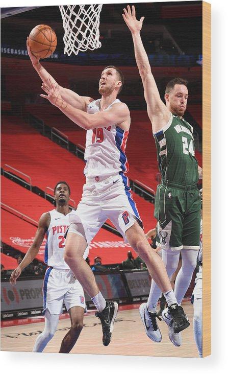 Nba Pro Basketball Wood Print featuring the photograph Milwaukee Bucks v Detroit Pistons by Chris Schwegler