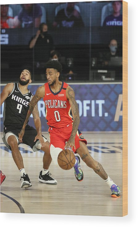 Nba Pro Basketball Wood Print featuring the photograph New Orleans Pelicans v Sacramento Kings by Joe Murphy
