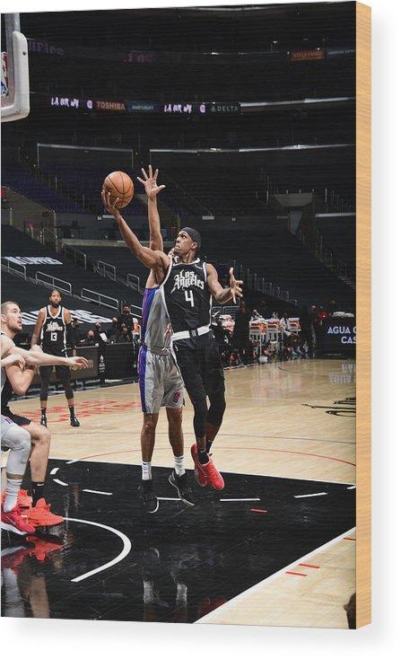 Nba Pro Basketball Wood Print featuring the photograph Rajon Rondo by Adam Pantozzi