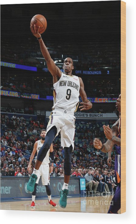 Smoothie King Center Wood Print featuring the photograph Rajon Rondo by Tyler Kaufman