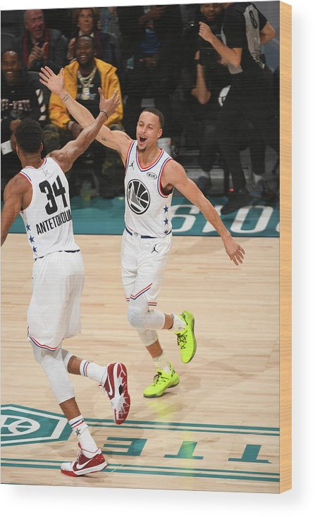 Nba Pro Basketball Wood Print featuring the photograph Stephen Curry and Giannis Antetokounmpo by Garrett Ellwood