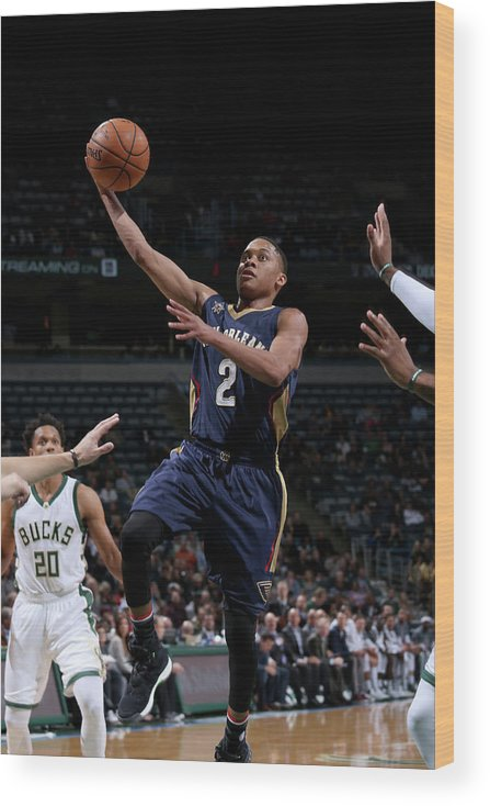 Nba Pro Basketball Wood Print featuring the photograph Tim Frazier by Gary Dineen