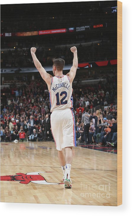 Nba Pro Basketball Wood Print featuring the photograph T.j. Mcconnell by Gary Dineen