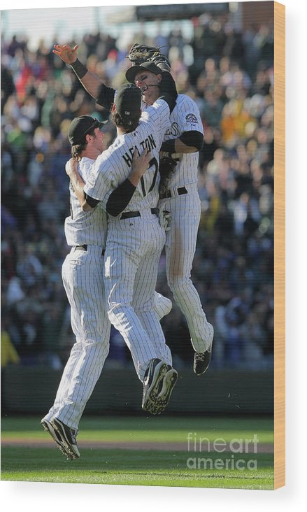 Celebration Wood Print featuring the photograph Todd Helton, Ian Stewart, and Troy Tulowitzki by Doug Pensinger