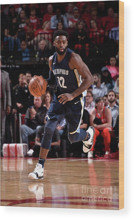 Nba Pro Basketball Wood Print featuring the photograph Tyreke Evans by Bill Baptist