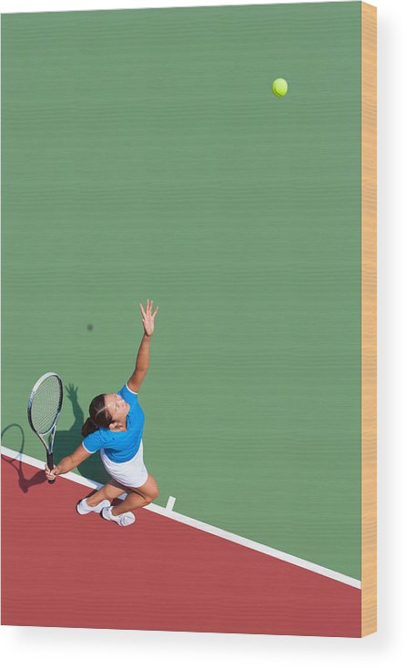 Asian And Indian Ethnicities Wood Print featuring the photograph Young tennis player serving by Nycshooter