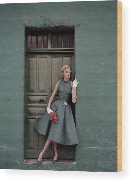 Fashion Wood Print featuring the photograph A 1950s Model Standing In A Doorway by Leombruno-Bodi