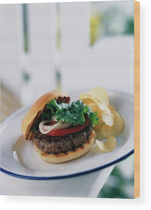 Cooking Wood Print featuring the photograph A Burger With Potato Chips by Romulo Yanes
