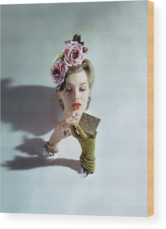 Accessories Wood Print featuring the photograph A Model Applying Lipstick by John Rawlings