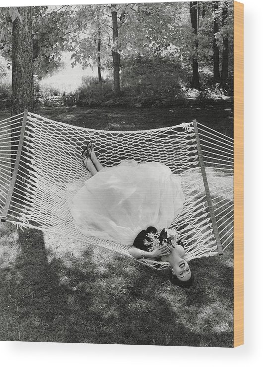 Landscape Wood Print featuring the photograph A Model Lying On A Hammock by Gene Moore