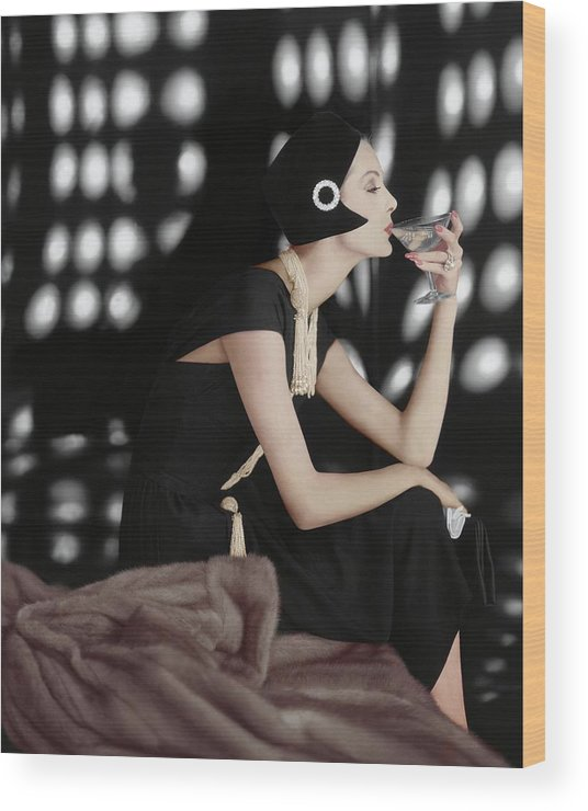 Fashion Wood Print featuring the photograph A Model Wearing A Branell Dress by Karen Radkai