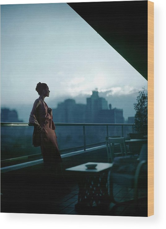 Fashion Wood Print featuring the photograph A Model Wearing A Clare Potter Dress At Moma by Constantin Joffe