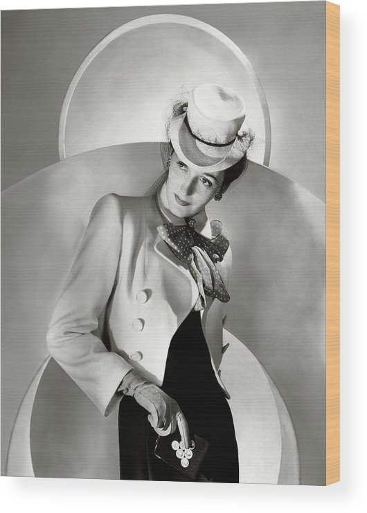 Coin Purse Wood Print featuring the photograph A Model Wearing A Jacket And Hat by Horst P. Horst
