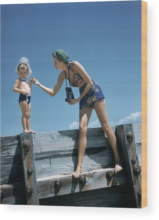 Children Wood Print featuring the photograph A Mother And Son On A Pier by Toni Frissell