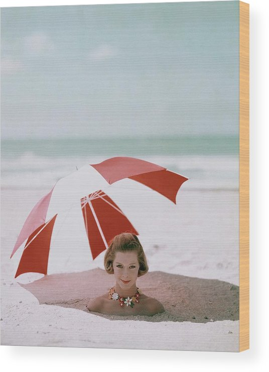 Beauty Wood Print featuring the photograph A Woman Buried In Sand At A Beach by Richard Rutledge