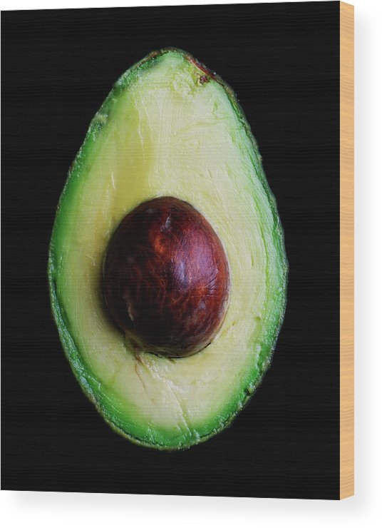 Fruits Wood Print featuring the photograph An Avocado by Romulo Yanes