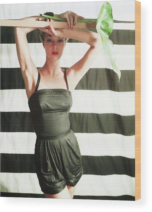 Studio Shot Wood Print featuring the photograph Jean Patchett Wearing Black Sunsuit by Horst P. Horst