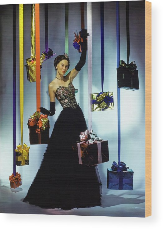 Accessories Wood Print featuring the photograph Model Wearing An Evening Gown Among Gifts by John Rawlings