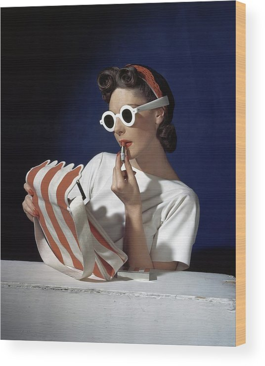 Accessories Wood Print featuring the photograph Muriel Maxel Applying Lipstick by Horst P. Horst