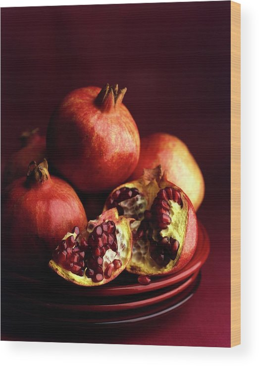 Fruits Wood Print featuring the photograph Pomegranates by Romulo Yanes