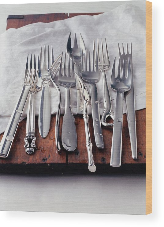 Kitchen Wood Print featuring the photograph Various Forks On A Wooden Board by Romulo Yanes