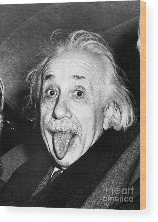 Physicist Wood Print featuring the photograph Albert Einstein Sticking Out His Tongue by Bettmann