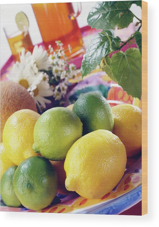 Close-up Wood Print featuring the photograph A Summer Table Setting With Lemons And by Steve Wisbauer