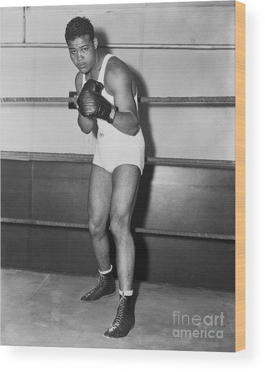 Young Men Wood Print featuring the photograph Boxing Champion Joe Louis by Bettmann
