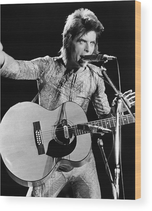Ziggy Stardust - Persona Wood Print featuring the photograph David Bowie Performing As Ziggy Stardust by Hulton Archive