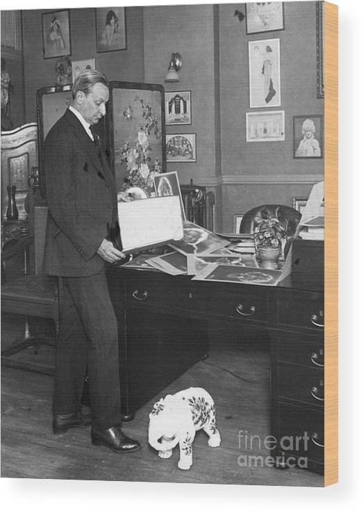 People Wood Print featuring the photograph Florenz Ziegfeld Looking At Photographs by Bettmann