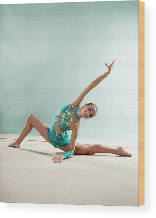 Human Arm Wood Print featuring the photograph Gymnast, Smiling, Bending Backwards by Emma Innocenti
