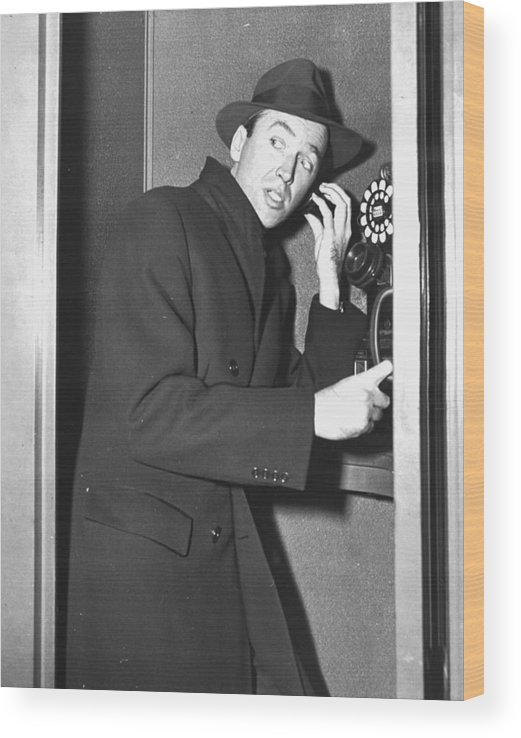 Jimmy Stewart Wood Print featuring the photograph James Stewart Stops To Make A Call At by New York Daily News Archive