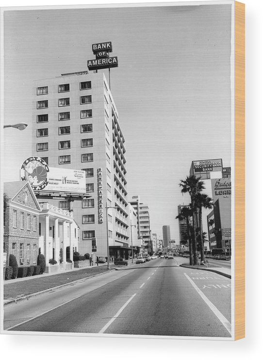 East Wood Print featuring the photograph Looking East On Wilshire Boulevard by American Stock Archive