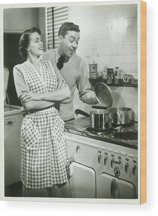 Heterosexual Couple Wood Print featuring the photograph Man Looking Into Pot In Domestic by George Marks