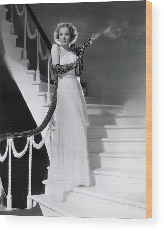 Smoking Wood Print featuring the photograph Marlene Dietrich Smoking On Staircase by Bettmann