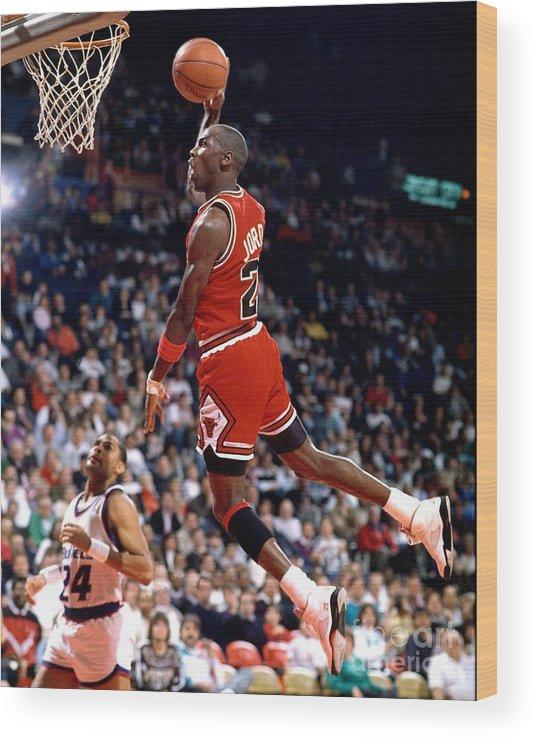 Chicago Bulls Wood Print featuring the photograph Michael Jordan Action Portrait by Jerry Wachter