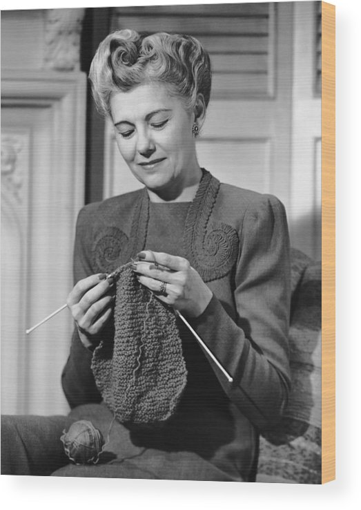 Mature Adult Wood Print featuring the photograph Portrait Of Mature Woman Crocheting by George Marks
