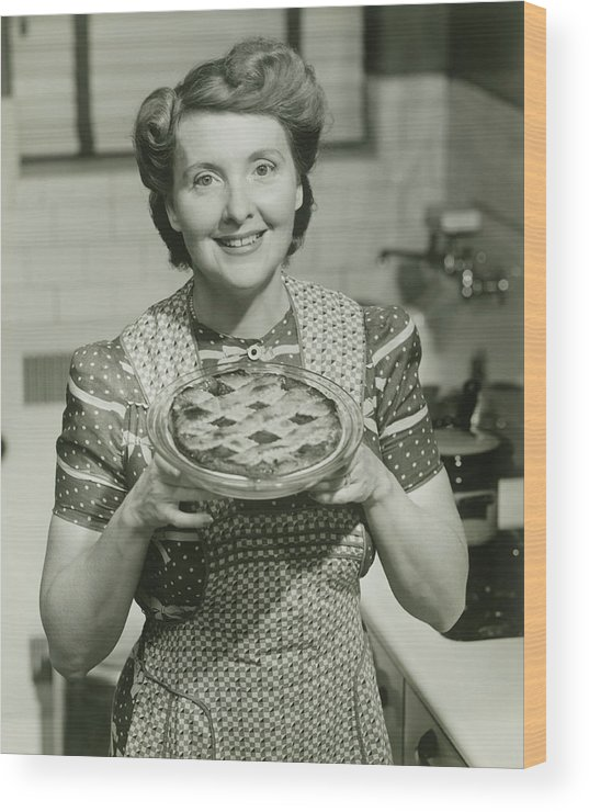 Mature Adult Wood Print featuring the photograph Portrait Of Mature Woman Holding Pie by George Marks