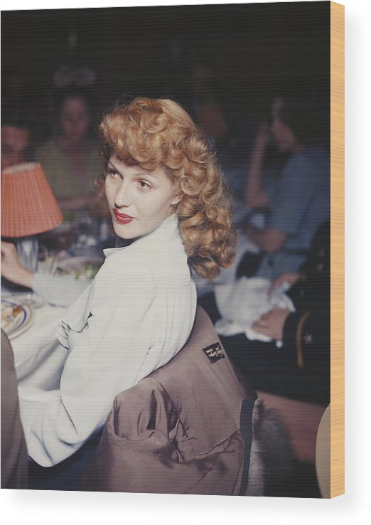 Looking Over Shoulder Wood Print featuring the photograph Rita Eats Out by Hulton Archive