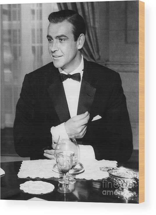 Adjusting Wood Print featuring the photograph Sean Connery As James Bond In Goldfinger by Bettmann