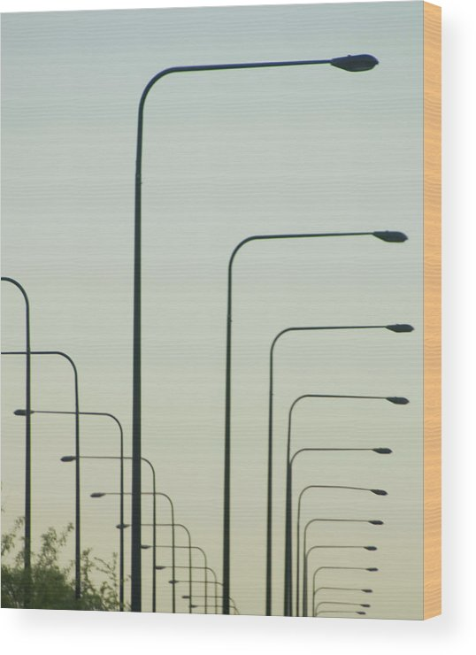In A Row Wood Print featuring the photograph Streetlights Against Afternoon Sky by By Ken Ilio
