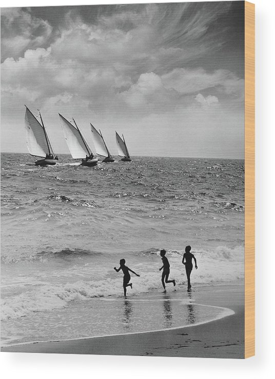 Following Wood Print featuring the photograph Three Boys Running Along Beach by Stockbyte