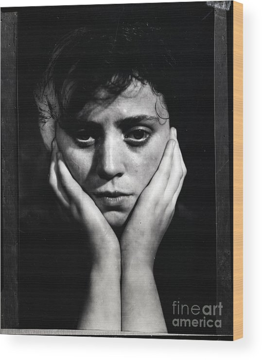 People Wood Print featuring the photograph Woman Holding Her Head by Bettmann