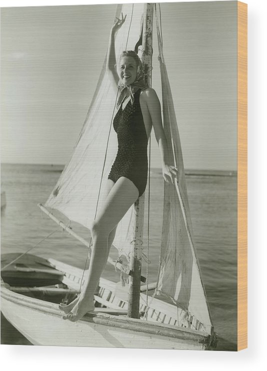 Human Arm Wood Print featuring the photograph Young Woman Posing On Sailboat by George Marks
