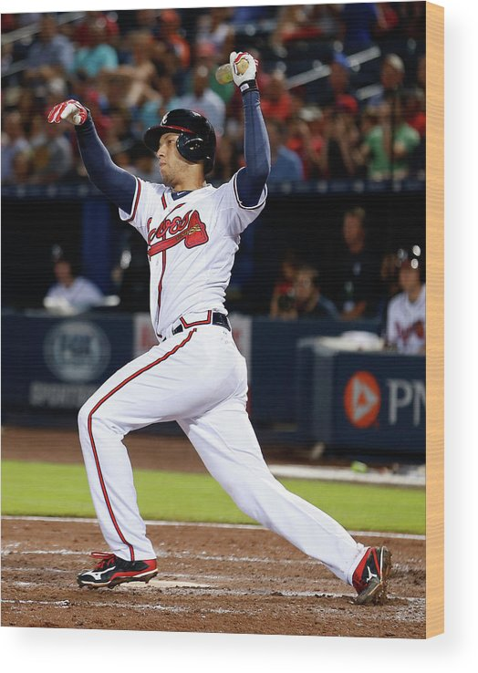 Atlanta Wood Print featuring the photograph Andrelton Simmons by Mike Zarrilli