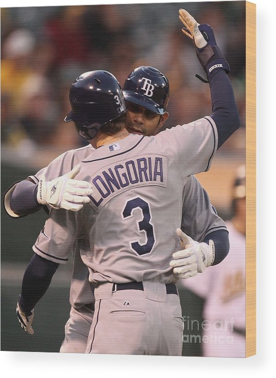 American League Baseball Wood Print featuring the photograph Carlos Pena and Evan Longoria by Jed Jacobsohn