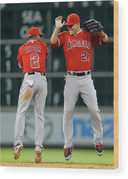 American League Baseball Wood Print featuring the photograph Erick Aybar and Mike Trout by Bob Levey